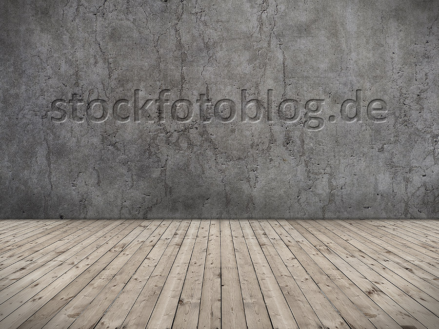 Leerer Raum mit Holzfussboden und Betonwand